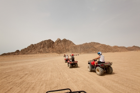 sinai: Quad bike safari in Egypt, outdoor horizontal shoot Stock Photo