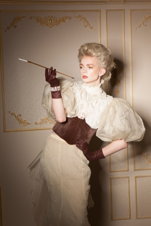 old english: Elegant portrait with old-fashioned cigarette holder Stock Photo