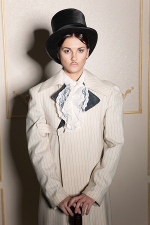 male costume: Woman in old-fashioned classic mens clothing Stock Photo