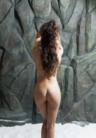 naked woman back: Sexy nude model posing in the studio Stock Photo