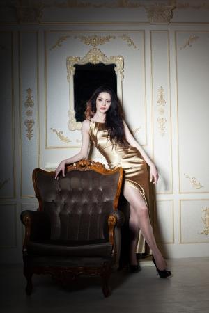 velvet dress: Elegant young girl in classic interior, studio shot