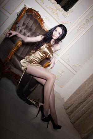 velvet dress: Girl sitting in an elegant chair, close up shot