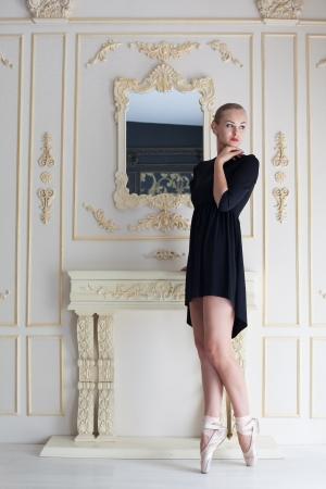 ballet studio: Modern ballet dancer posing, studio shot