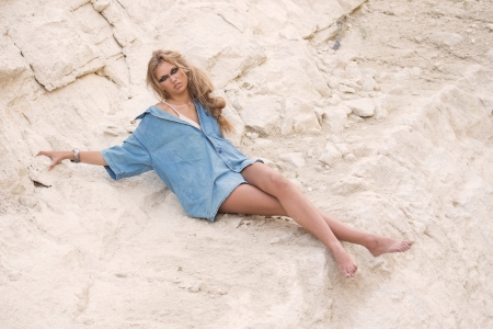 oversize: Girl in oversize t-shirt over stone-pit background, outdoor shoot