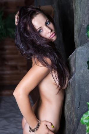 nude female buttocks: Sexy nude brunette girl, studio close up shot Stock Photo