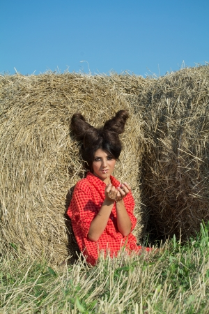 wild hair: Girl with devil image in countryside, summer shoot