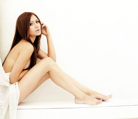A model over white background, outdoor shot Stock Photo