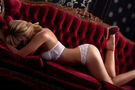 Sexy posing blond girl in white lingerie photo