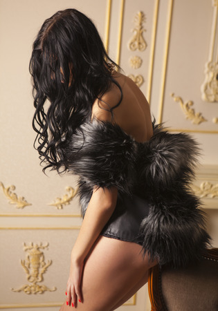 brunette naked: Anonymous brunette naked girl covering with fur jacket