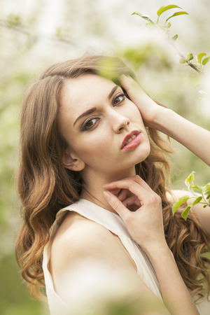 pureness: Portrait of a brunette girl in the garden, close up shot