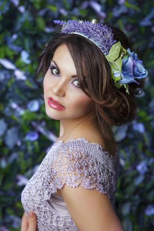 coronet: Brunette girl with the coronet from flowers, portrait shot