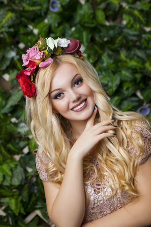 circlet: Cute smiling blond girl with circlet from flowers, close up shot Stock Photo