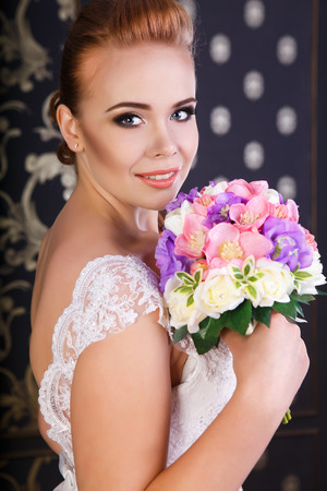 redhaired: Red-haired beautiful bride with flowers Stock Photo
