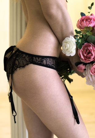 erotical: Handmade panties made from black lace and silk Stock Photo