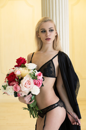 erotical: Girl in underwear with roses, studio shot