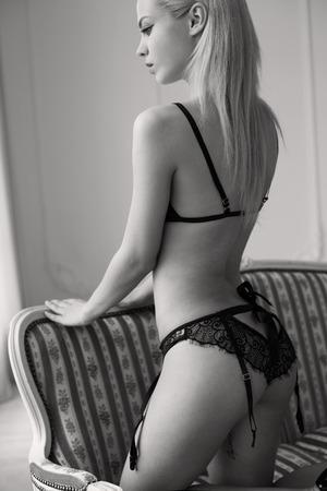 tiny: Girl in sexy black lingerie set