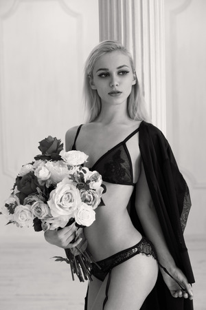erotical: Girl in underwear with roses, monochrome shot