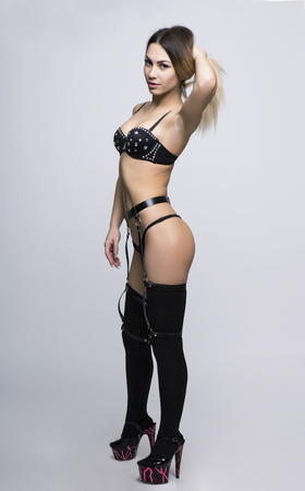 belly bandage: Striptease girl in sexy underwear and stockings.