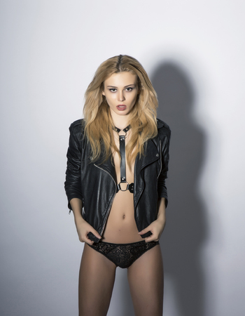 Sexy girl in black leather clothing