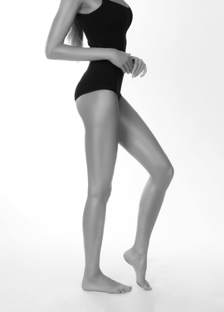 Profile of a slim womans body, studio isolated monochrome shot