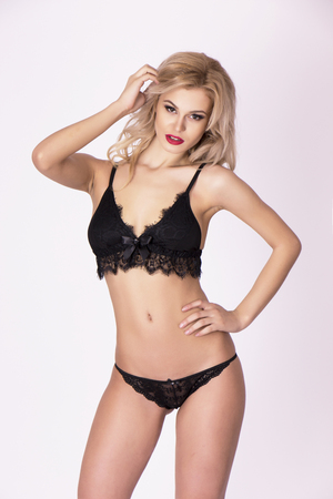 Sexy black lace lingerie on blonde attractive model