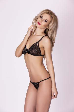 Sensual blonde woman in sexy black lace underwear