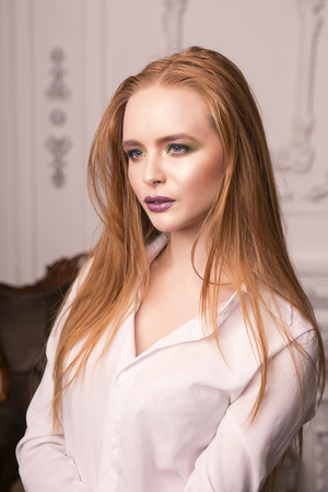 northern light: Elegant looking ginger girl with casual make up. Studio shot. Stock Photo