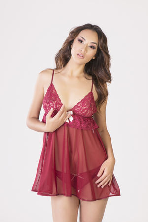 74dbd6a525 Vertical studio isolated shot of a sexy asian model in silky red nighty set