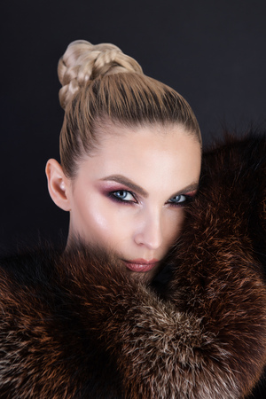 Sexy portrait of lady with nice make up wearing natural bordo fur