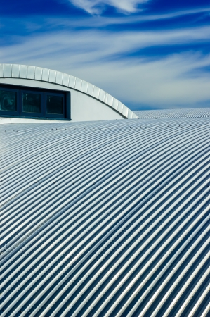 Metallic roof and blue sky with clouds Stock Photo - 17930488