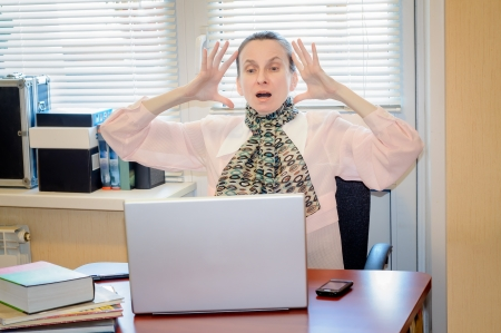 A fifty years old woman very angry with the modern technology Stock Photo - 18943284