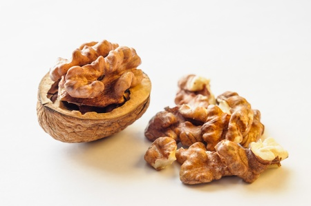 A close up of an open walnut on white background Imagens