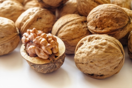 Close up of a heap of dry tasty walnuts Stock Photo