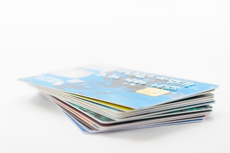 A pile of several colored credit cards 스톡 콘텐츠