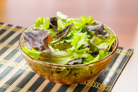 Mixed red and green salad on a table