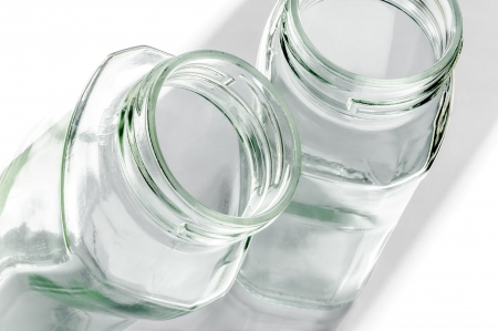 highkey: Transparent glass jars on white, with high-key effect
