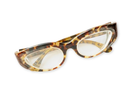 Old tortoise spectacles on a white background Stock Photo