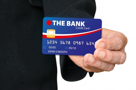 A man holding a credit card in his hand, and showing it photo