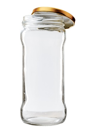 High transparent glass jar on white background, with the open gold color top