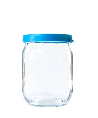 Transparent glass jar on white background, with the closed plastic blue top