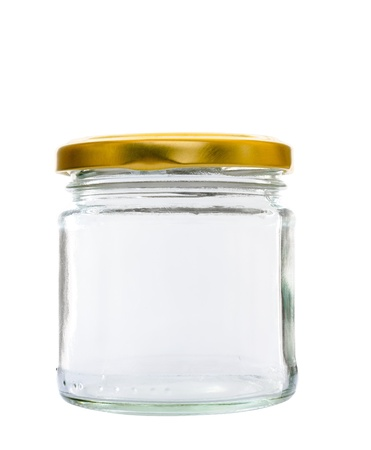 Transparent glass jar on white background, with the closed gold color top