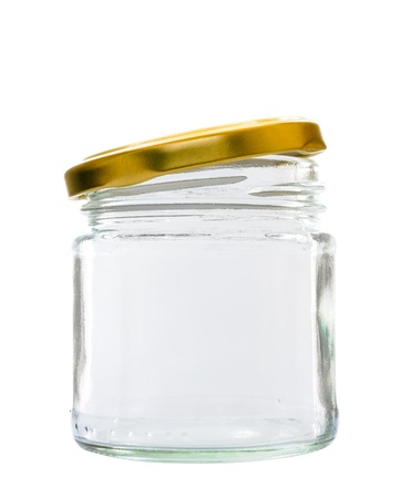 Transparent glass jar on white background, with the open gold color top Stock Photo