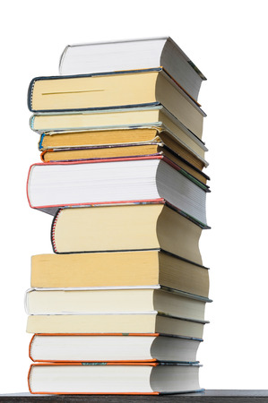 A stack of different books seen from a low point of view
