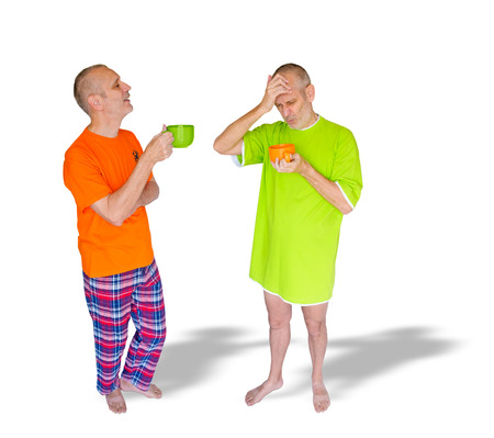 nightdress: A couple of twin men drinking coffee after waking up. One is in green nightdress, holding an orange cup, the other is in pajamas with an orange T-shirt, and is holding a green cup