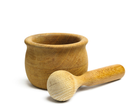 Olive wood mortar and pestle on white background Stock Photo