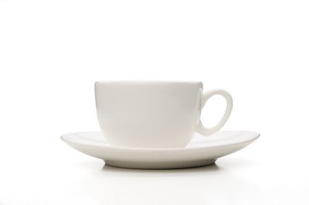 A simple white tea or coffee cup viewed from profile
