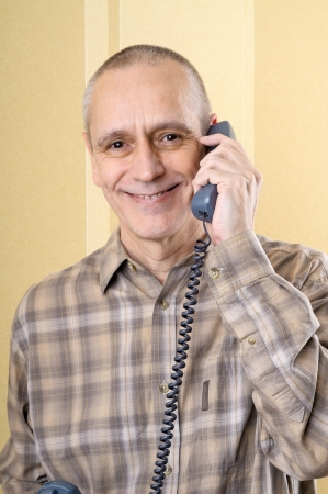 neighbourly: A very happy smiling man with a phone in hand Stock Photo