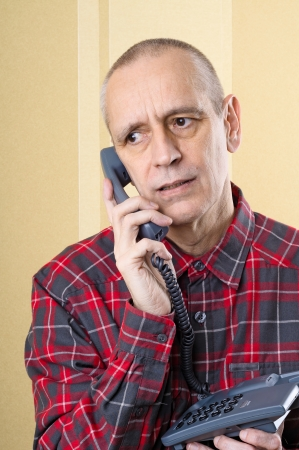 solicitous: Troubled man speaking about problems on phone Stock Photo