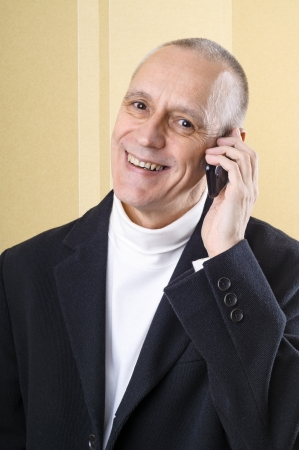 neighbourly: Happy businessman having good news on mobile phone Stock Photo