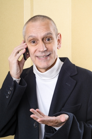 neighbourly: Amicable businessnam speaking on mobile phone and moving the hand Stock Photo